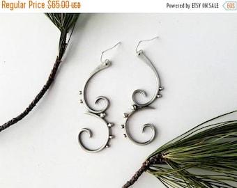 swirling spiral earrings, sterling silver handmade earrings, feminine tribal