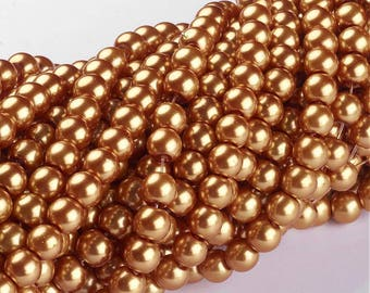 """Golden Glass Pearls - 6mm - Sold per 32"""" strand"""