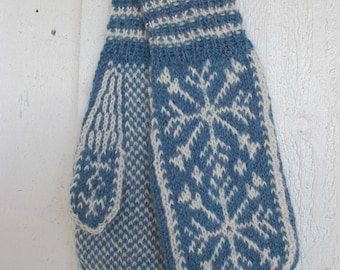 Handknitted mittens with snow crystals