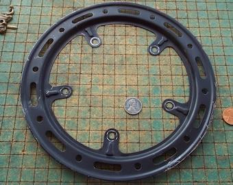 Bicycle sprocket chain guard, round, painted steel, old bike parts, kinda beat up,  industrial, great for found art metal sculpture,
