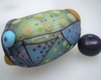 Moogin Beads- Detailed abstract oval focal , lampwork / glass bead set   - SRA