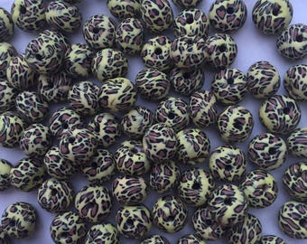 Pack of 10 x 9x6mm polymer clay abacus light leopard print beads.