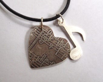 Silver heart with music notes necklace black greek leather cord