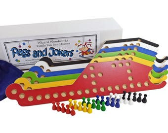 New PEGS and Jokers 6-Player Game with Interlocking paddles.