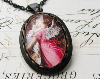 In the Arms of an Angel necklace made with Fallen Angel Brass, handmade glass cabochon, black brass, angel pendant, angel charm, wings