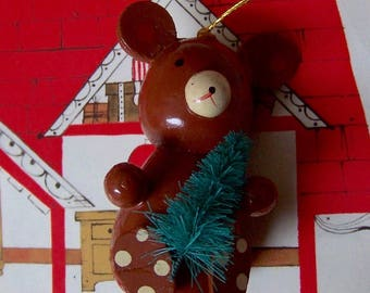 adorable little bear with tree ornament