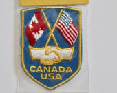 Vintage 1970s Canada and United States Collection Travel Crest Souvenir Patch - Unopened Original Packaging