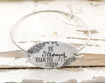 Hand stamped Be Stronger Than The Storm bangle bracelet inspirational jewelry affirmation jewelry swivel hook bracelet