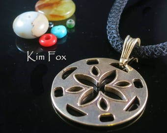 Cut Flower Pendant 1 1/2 by 2 inches in sterling silver or golden bronze -two sided - designed by Kim Fox