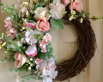Spring Slpendor-roses, hydrangea and baby white buds bursting from a grapevine wreath.