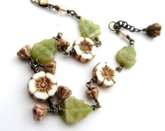 Flower leaf bracelet, earthy colors opaque glass, antiqued brass, cream green brown, botanical theme, rustic look, floral bead jewelry