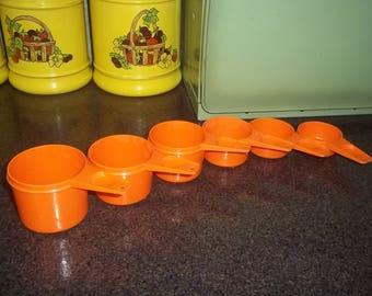 Vintage Tupperware Measuring cups in brilliant orange in really great condition