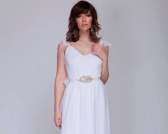 Romantic wedding dress ruffled delicate sleeves and low back