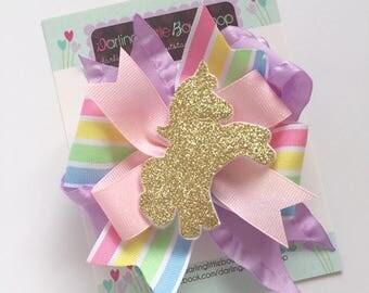 Unicorn Bow, Unicorn hair bow -- Pastel rainbow ribbons with golden unicorn center