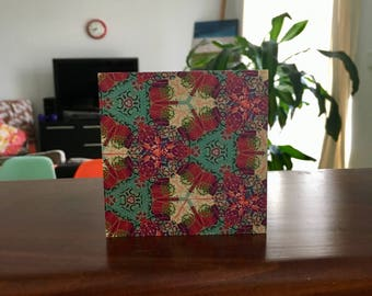 Red and green kaleidescope woodblock artwork