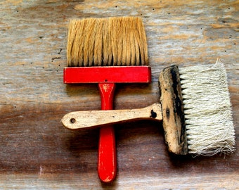 vintage brushes wooden handles industrial display, painter's tool, large wooden handle brushes