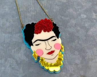 Perspex and glitter Frida Kahlo laser cut necklace. Red glitter and turquoise