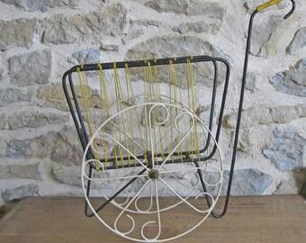 Funky magazine rack, wheel along mid century magazine holder in metal with yellow scoubidou
