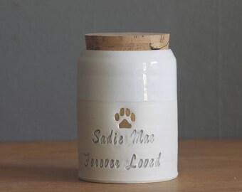 custom pet urn. script font shown, small collar shape. human ashes urn, pet urn. white on white porcelain. modern pottery urn, custom text
