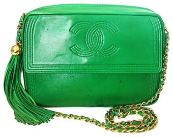 Vintage CHANEL rare color, green lamb leather camera bag style chain shoulder purse with gold tone chain strap and fringe. CC stitch mark