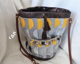 handbag faux leather fabric and bronze shapes geometric