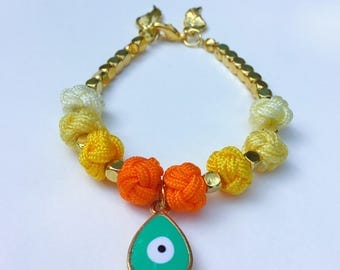Turqoise evil eye charm bracelet with orange & yellow chinese fabric knot beads with wings charm