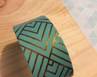 manchette turquoise geometrique