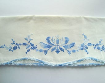 Vintage white pillowcase with blue embroidery and cross stitching