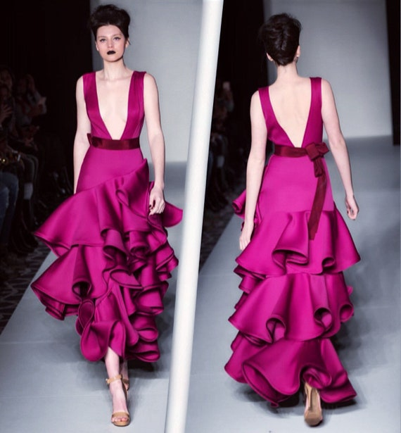 Fuchsia ruffled deep V neckline dress.