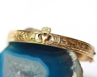 Vintage claddagh gold clamp bracelet with floral pattern