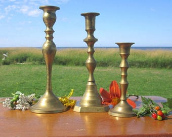 3  Brass  Candle Holders Staggered sizes Unique grouping  set sticks Made in India