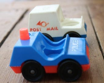 Vintage Fisher Price police and Royal Mail cars