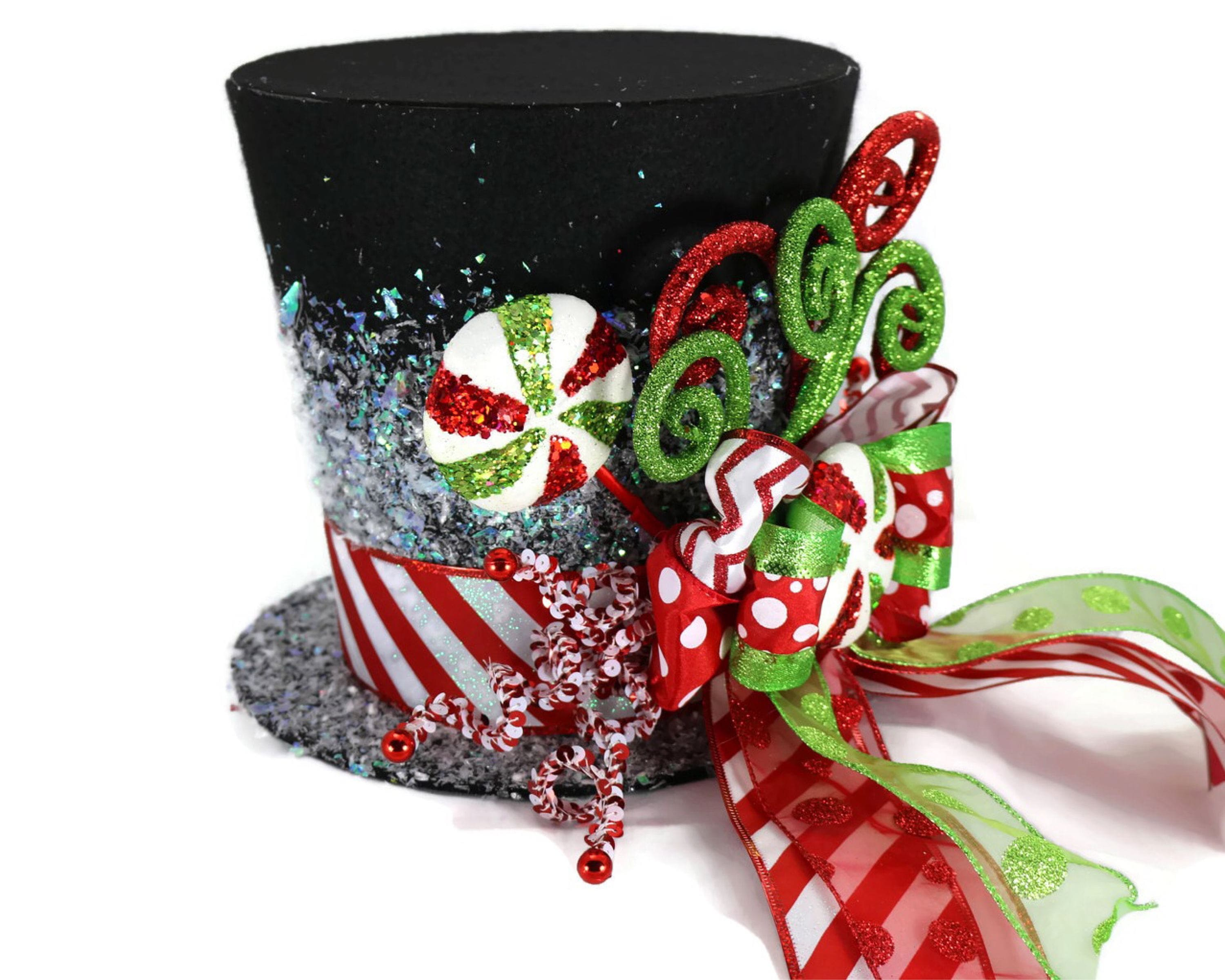 Candy christmas tree topper black candy cane tree topper for Chocolate christmas decorations