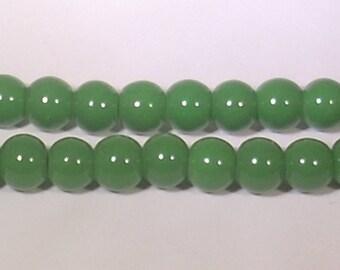 Dark green glass 8mm round beads