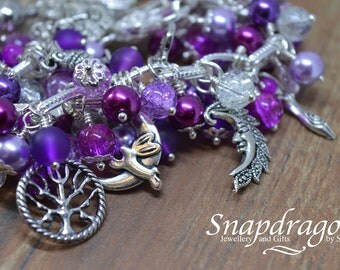 Rich purple fully loaded charm bracelet with wicca goddess charms