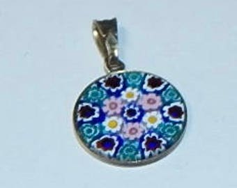 Milifiori Italian glass pendant with gold clasp and bezel about 1/2""
