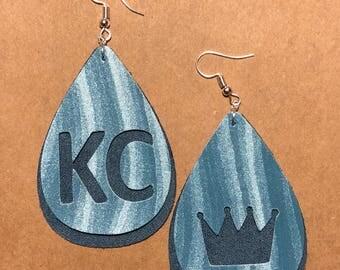 KC cutout leather earrings.