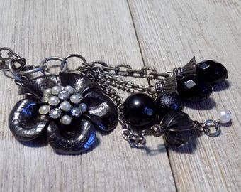 black flower necklace with pearl cluster accent