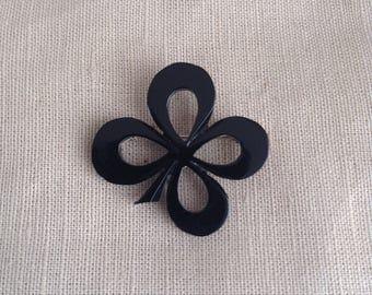 """1920's black """"clover"""" brooch"""