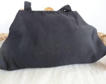 Black Fabric Handbag With Decorative Frame