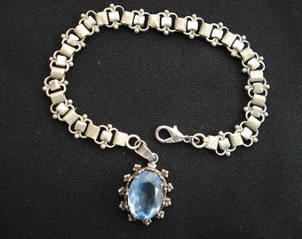 Antique French silvered chain bracelet with breloque / medal / fob / brelogue inside blue stone.   ( 11 C )