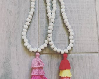 Tiered tassel necklaces