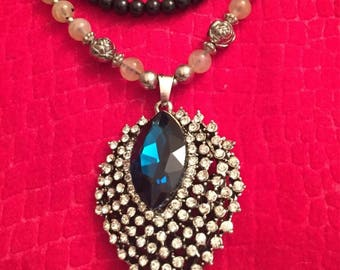 Statement necklace features a blue and clear rhinestone charm on a beaded strand, sweater necklace, gifts for her