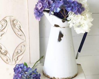 A lovely classic white French enamel pitcher