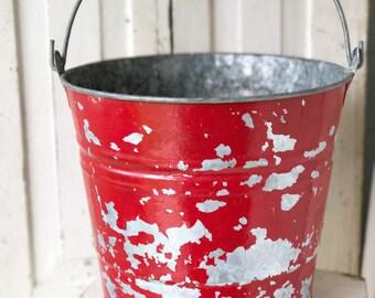 A wonderful vintage red chippy paint zinc bucket