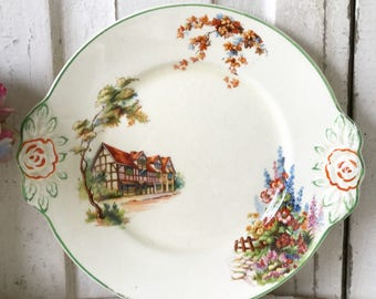 A lovely Woods Ivory Ware cottage garden cake plate