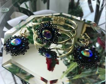 9in gold/black crystal braclet with matching pierced earrings