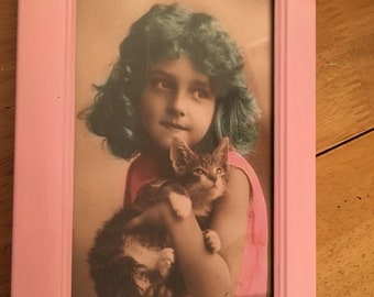 Vintage girl blue hair and kitten in pink frame