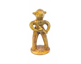 Ceramic figure by Julia Ramalho. Musician Keys.