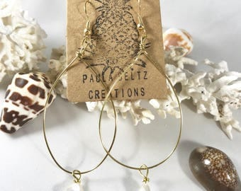 Gold colored tear drop earrings with freshwater pearls